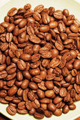 Coffee beans on plate — Stock Photo