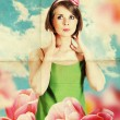 Art collage with beautiful woman in tulips — Stock Photo