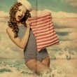 Beauty pin-up woman with bag - Stock Photo