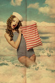 Beauty pin-up woman with bag — Stock Photo