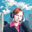 Handsome woman working in a call center - Stock Photo