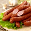 Delicious smoked sausages — Stock Photo