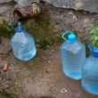 Stock Photo: Bottles with water from spring