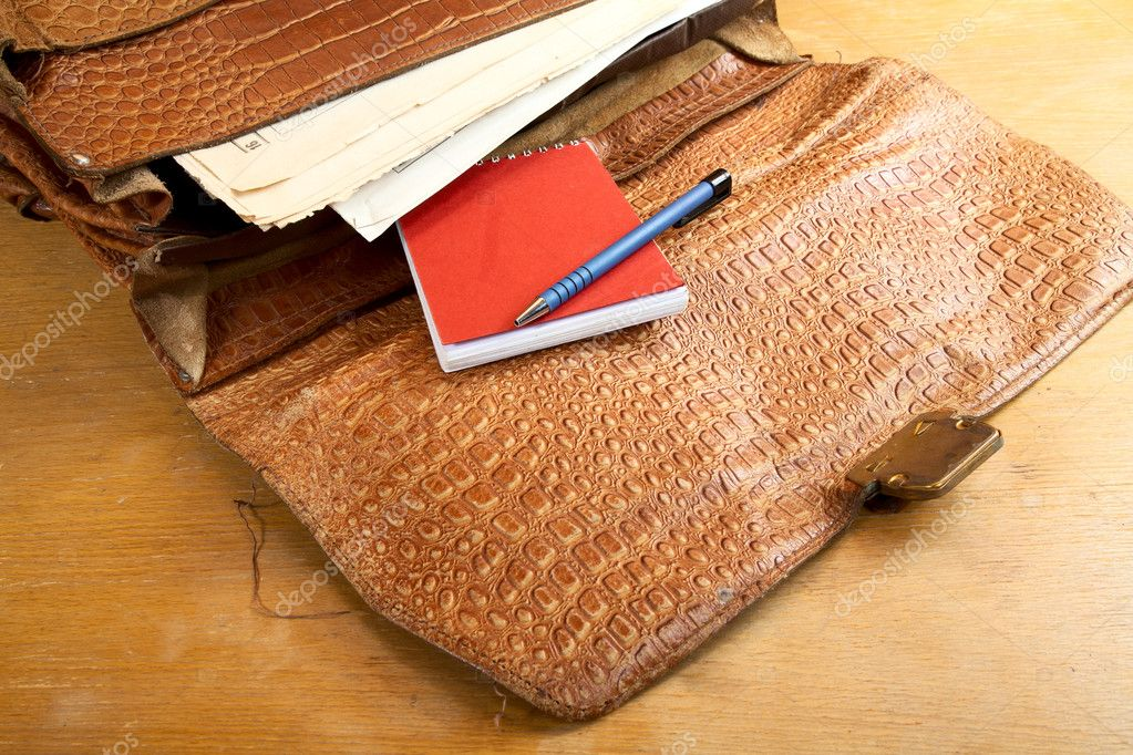 Old portfolio from a crocodile leather on  desk — Stock Photo #7971660