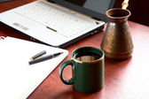 Cup of morning coffee on a table at office — Stock Photo