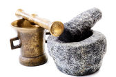 Granite and brass mortar with pestles on a white — Stock Photo