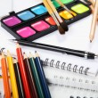 Albums with water colour paints and pencils — Stock Photo