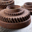 Rusty  gear wheels on a board — Stock Photo