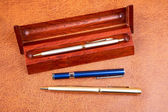 Three pens on a textural — Stock Photo