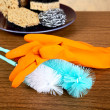 Gloves ,sponge, brush for ware washing - Stock Photo