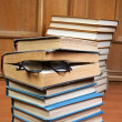 Two piles of old books and glasses - Stock Photo