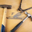 Two hammers and pincers with nails — Stock Photo