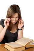 Girl with glasses and the open book isolated on a white — Stock Photo