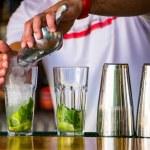 Barmen mixes a cocktail — Stock Photo #10693565