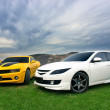 Mazda 6 and Chevrolet Camaro — Stock Photo