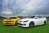 Mazda 6 and Chevrolet Camaro — Stock Photo