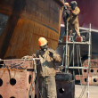 Stock Photo: Workers repaired ship