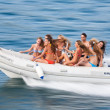 Girls ride on a boat — Stock Photo