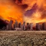 City overlooking desolate landscape — Stock Photo