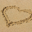 Heart drawn on sand — Stock Photo