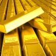 Stacks of gold bars close up - Stock Photo