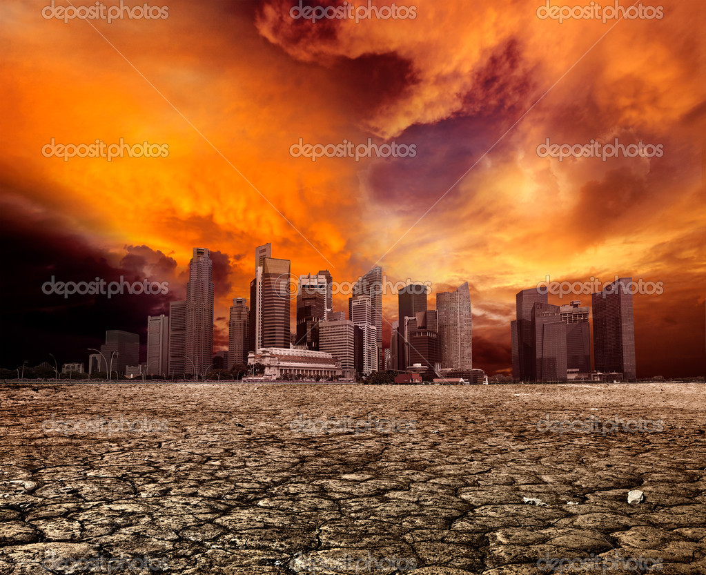 City overlooking desolate desert landscape with cracked earth — Stock Photo #9140954