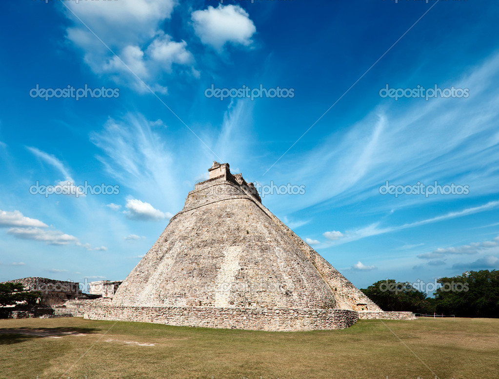 Ancient mayan pyramid (Pyramid of the Magician, Adivino) in Uxmal, Mexico  Stock Photo #9141004