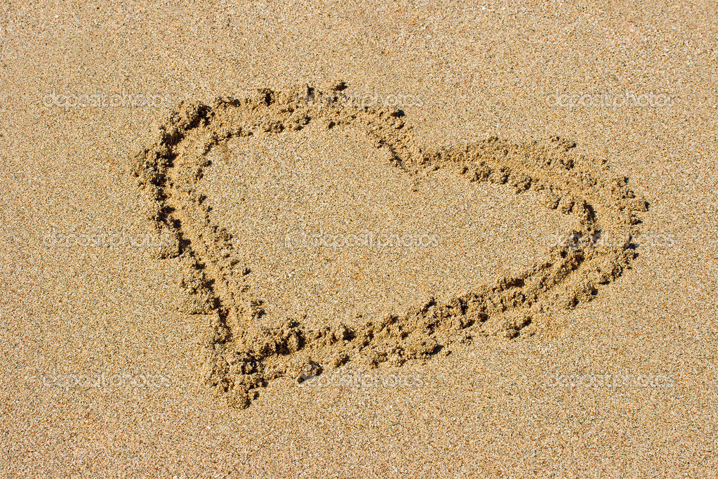 Heart drawn on beach sand  Stock Photo #9141022