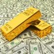 Gold bars on dollars — Stock Photo