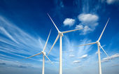 Wwind generator turbines in sky — Stock Photo