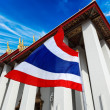 Thailand flag and Buddhist temple - Stock Photo