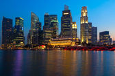 Singapore skyline and river in evening — Stock Photo