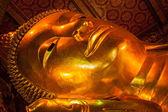 Reclining Buddha face — Stock Photo