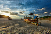 Long tail boat on beach on sunset — Stock Photo