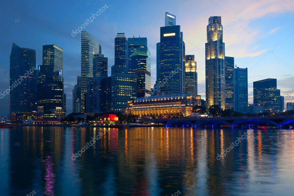 Singapore skyline and Marina Bay in evening  Stock Photo #9778153