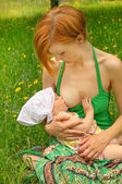 Mother feeding her baby — Stock Photo