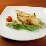 Rolled pancakes stuffed chicken — Stock Photo