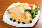 Roasted plaice with potatoes — Stock Photo