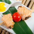 Japanese skewered  salmon — Stock Photo