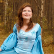 Girl in medieval dress in autumn wood — Stock Photo