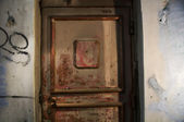 Old door.Abandoned grungy interior — Stock Photo