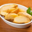 Baked potatoes wedges — Stock Photo
