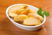 Baked potatoes wedges — Stock Photo