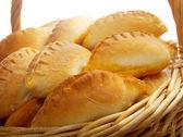 Basket full of pasties — Stock Photo