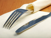 Fork and a knife lie on serviette — Stock Photo