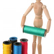 Mannequin and colored thread — Stock Photo