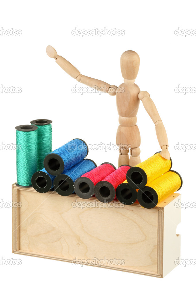 Dummy - seller of colored thread isolated on white background — Stock Photo #9682033