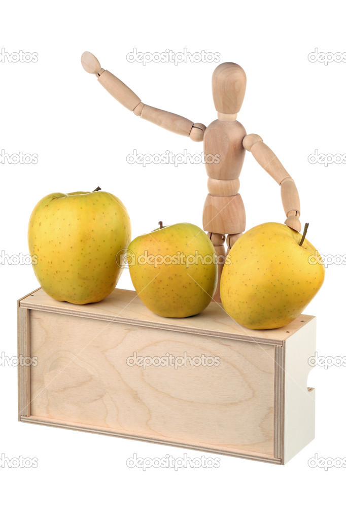 Dummy - seller of yellow apples isolated on white background  Stock Photo #9727611