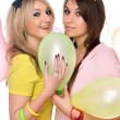 Sexy girls holding a balloon — Stock Photo