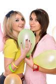 Sexy girls holding a balloon — Stock Photo
